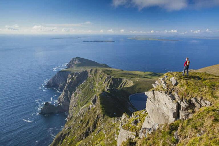 Walker looking towards Saddle Head from Croaghaun, Achill Island, Co Mayo